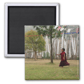 Young monk and prayer flags magnet