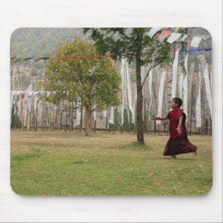 Young monk and prayer flags mouse pad