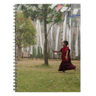 Young monk and prayer flags notebook