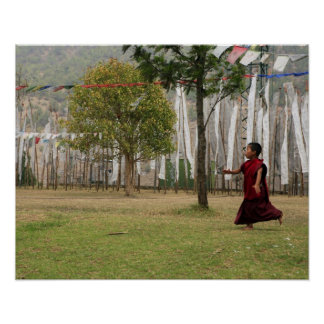 Young monk and prayer flags poster
