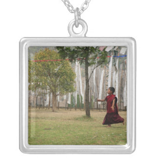 Young monk and prayer flags silver plated necklace