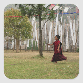 Young monk and prayer flags square sticker