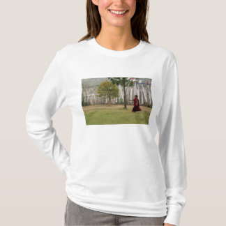 Young monk and prayer flags T-Shirt