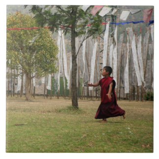 Young monk and prayer flags tile