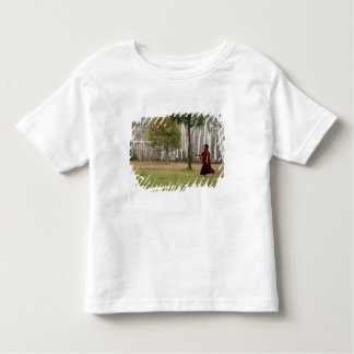 Young monk and prayer flags toddler t-shirt