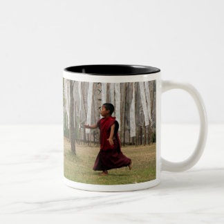Young monk and prayer flags Two-Tone coffee mug