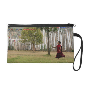 Young monk and prayer flags wristlet