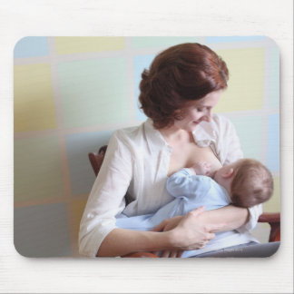 young mother breast feeding her baby boy mouse pad