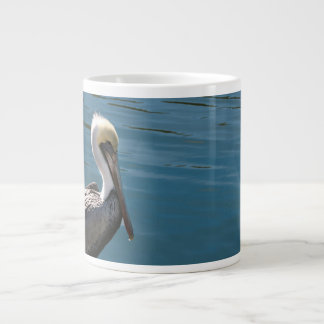 young pelican against water on left large coffee mug