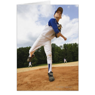 Young pitcher throwing baseball from mound card