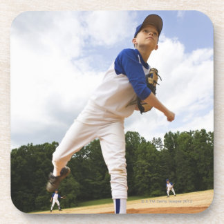 Young pitcher throwing baseball from mound drink coaster