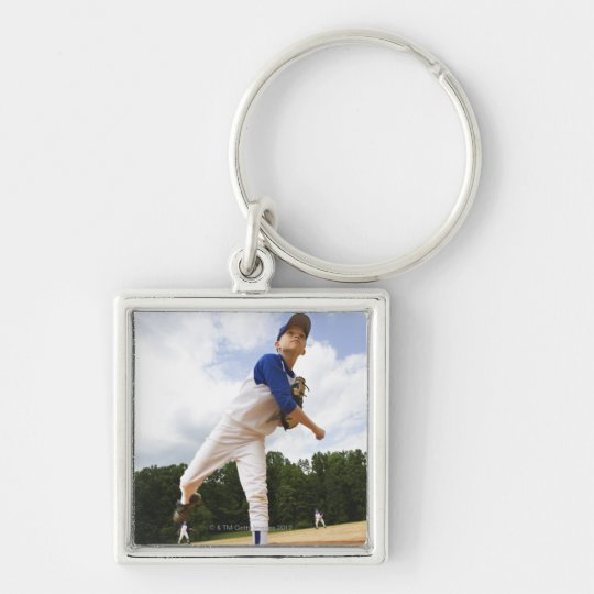 Young pitcher throwing baseball from mound keychain