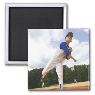 Young pitcher throwing baseball from mound magnet