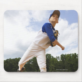 Young pitcher throwing baseball from mound mouse pad