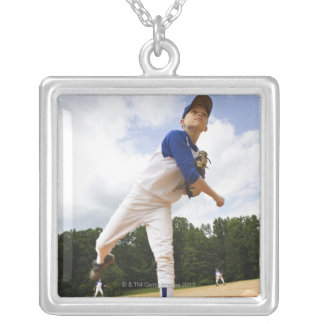 Young pitcher throwing baseball from mound necklace