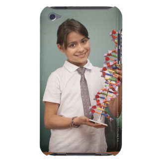 Young schoolgirl holds a colorful model barely there iPod cover