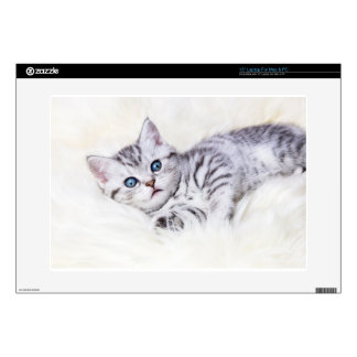 """Young silver tabby spotted cat lying on sheep skin 15"""" laptop skin"""