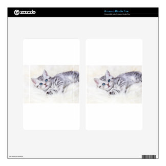 Young silver tabby spotted cat lying on sheep skin kindle fire skins