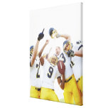 Young sportsmen playing rugby stretched canvas print