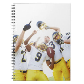 Young sportsmen playing rugby notebook