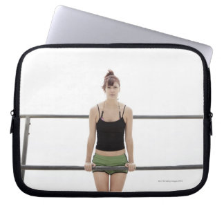 young sporty woman on a holm outside laptop sleeve