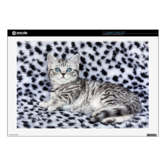 """Young spotted cat  lying on black and white fur decal for 17"""" laptop"""