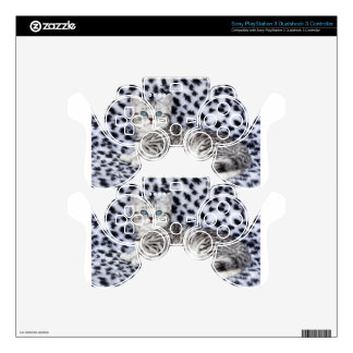 Young spotted cat  lying on black and white fur decal for PS3 controller