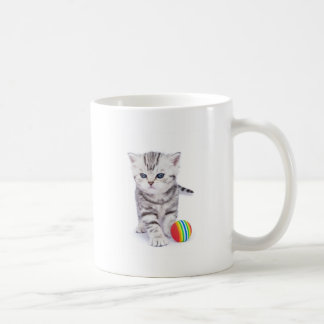 Young standing silver tabby cat with colorful ball coffee mug