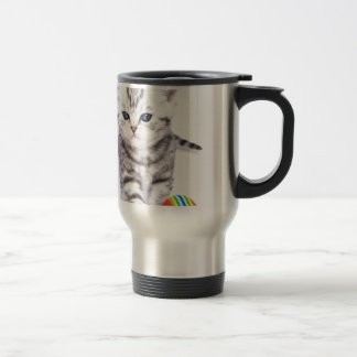 Young standing silver tabby cat with colorful ball travel mug