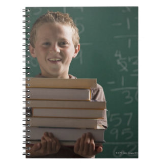 Young student in classroom notebook