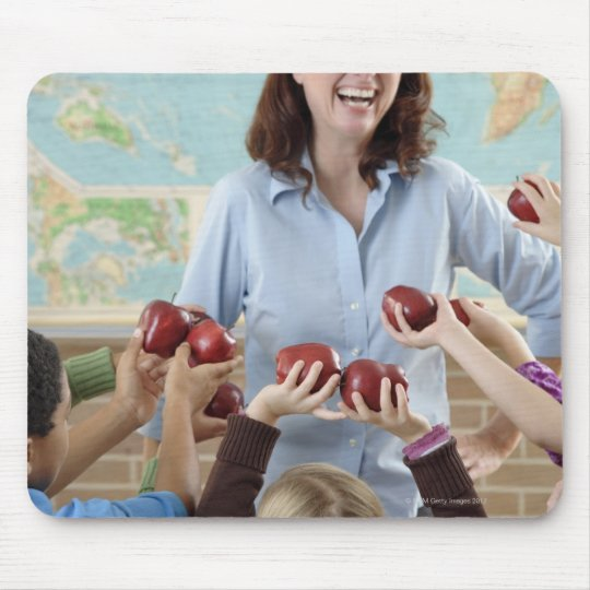 young students presenting apples to teacher mouse pad
