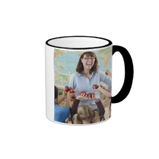 young students presenting apples to teacher ringer coffee mug