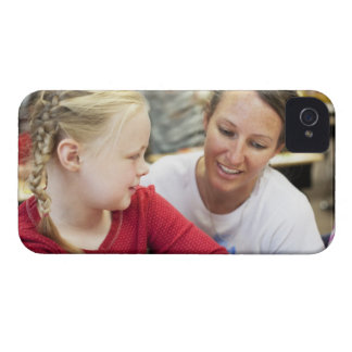 young teacher discussing homework w/ student Case-Mate iPhone 4 case