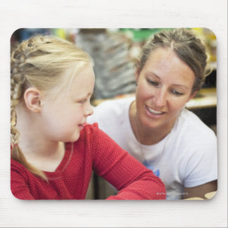 young teacher discussing homework w/ student mouse pad