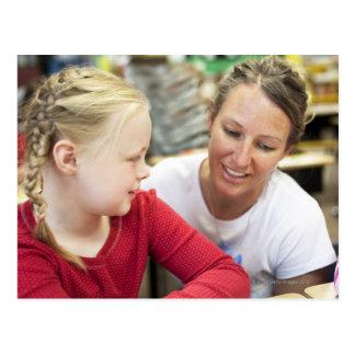 young teacher discussing homework w/ student postcard
