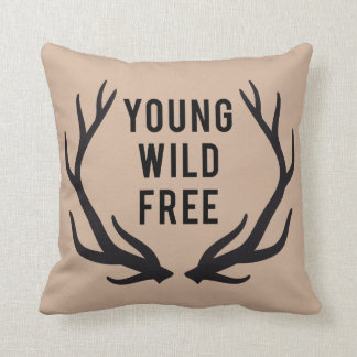 young, wild, free, text design with deer antlers throw pillow