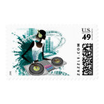 Young woman Dj Using Turntable in Nightclub Stamps
