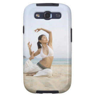 Young woman doing yoga on the beach galaxy SIII cover