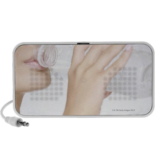 young woman drinking water,close-up mini speaker
