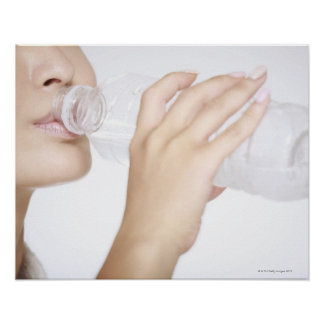 young woman drinking water,close-up posters