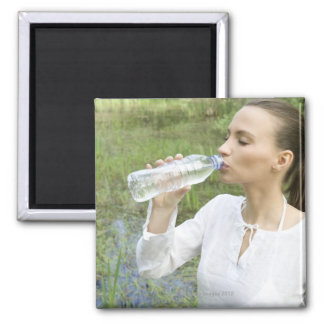 young woman drinking water from bottle 2 inch square magnet