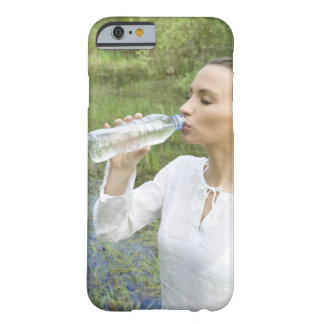 young woman drinking water from bottle barely there iPhone 6 case