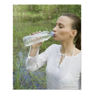 young woman drinking water from bottle print