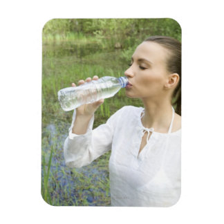 young woman drinking water from bottle rectangular photo magnet