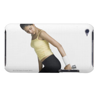 Young woman exercising with a dumbbell iPod Case-Mate case