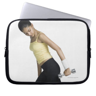 Young woman exercising with a dumbbell computer sleeve