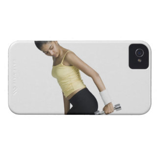 Young woman exercising with a dumbbell iPhone 4 case