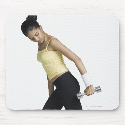 Young woman exercising with a dumbbell mouse pad