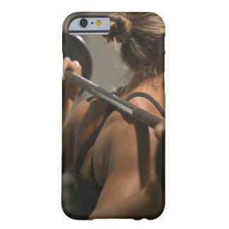 Young woman exercising with barbell, rear view barely there iPhone 6 case