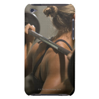 Young woman exercising with barbell, rear view barely there iPod cover